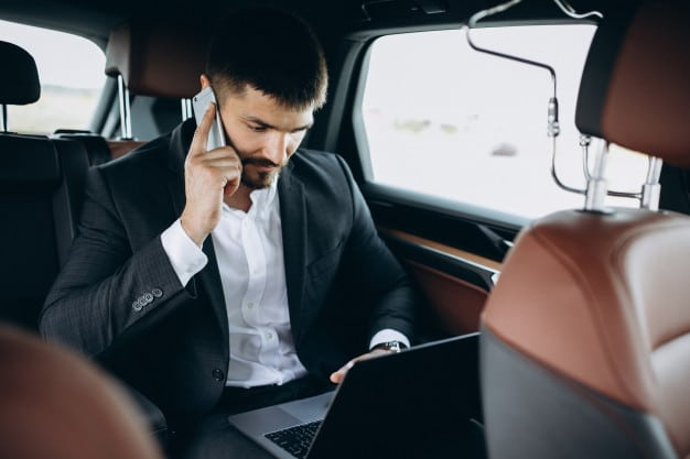 handsome-business-man-working-computer-car_1303-16421