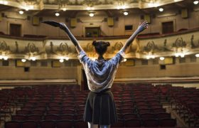 rear-view-female-mime-raising-her-arms_23-2147891793